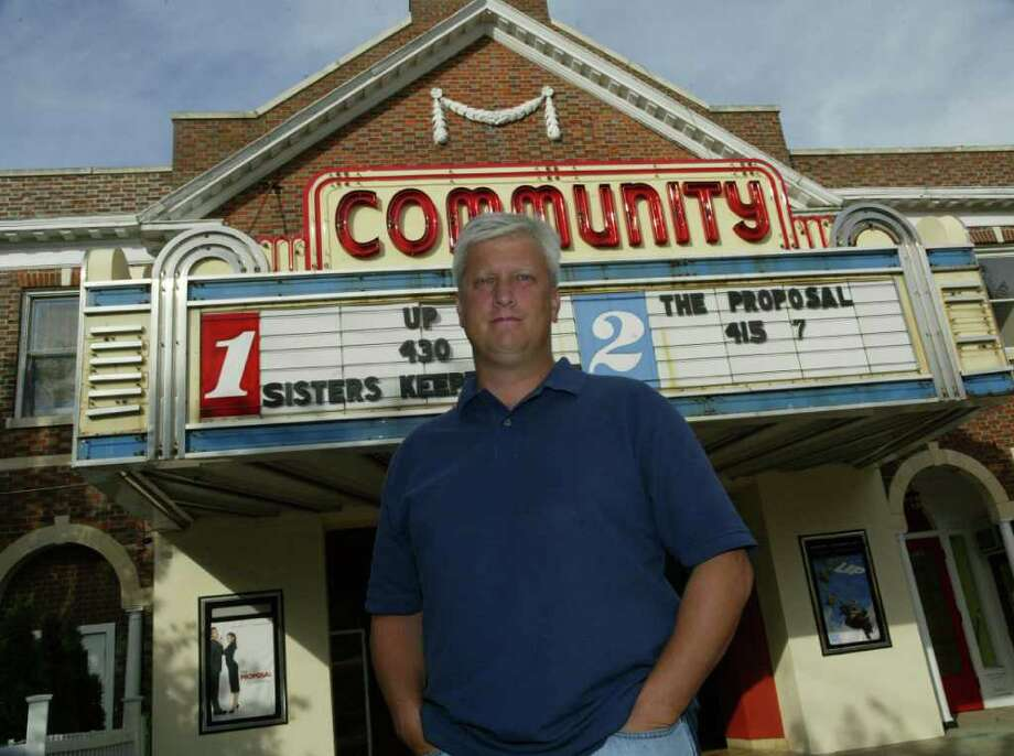 Leo Redgate, stands in front of the Community Theater on the corner of Unquowa and Post Roads in 2009. Ten years ago, Leo Redgate won plaudits when he stepped in to reopen the landmark Community Theatre. Now Redgate wants someone else or a sponsoring organization to take over running the theater, which closed without warning several weeks ago, allowing for some renovations. But, he adds, he does not plan to keep running the theater much longer. Photo: Phil Noel, File Photo / Connecticut Post