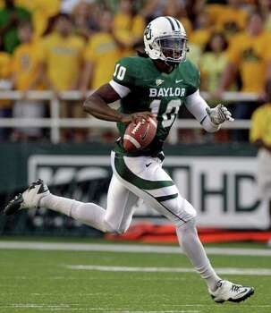 Baylor quarterback Robert Griffin III finds running room against Stephen F. Austin in the first half of an NCAA college football game, Saturday, Sept. 17, 2011, in Waco, Texas. (AP Photo/Tony Gutierrez) Photo: Tony Gutierrez, Associated Press / AP