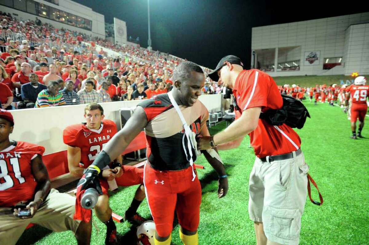 Cardinals running back DePauldrick Garrett has his shoulder iced by a Lamar trainer after diving into the end zone to score in the first half against Incarnate Word at Provost Umphrey Stadium Saturday, September 17, 2011. Valentino Mauricio/The Enterprise