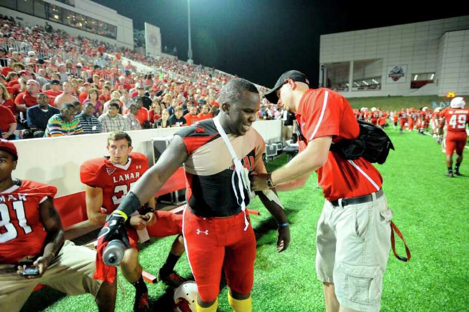 Cardinals running back DePauldrick Garrett has his shoulder iced by a Lamar trainer after diving into the end zone to score in the first half against Incarnate Word at Provost Umphrey Stadium Saturday, September 17, 2011. Valentino Mauricio/The Enterprise Photo: Valentino Mauricio