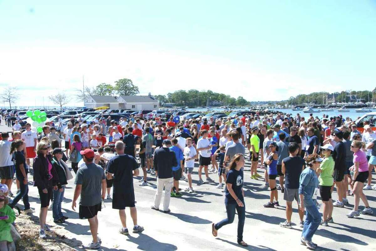 Crowds of runners, friends, family, and organizers fill Pear Tree Point Beach for the 32nd Annual Darien Road Race on Sunday, September 18, 2011.
