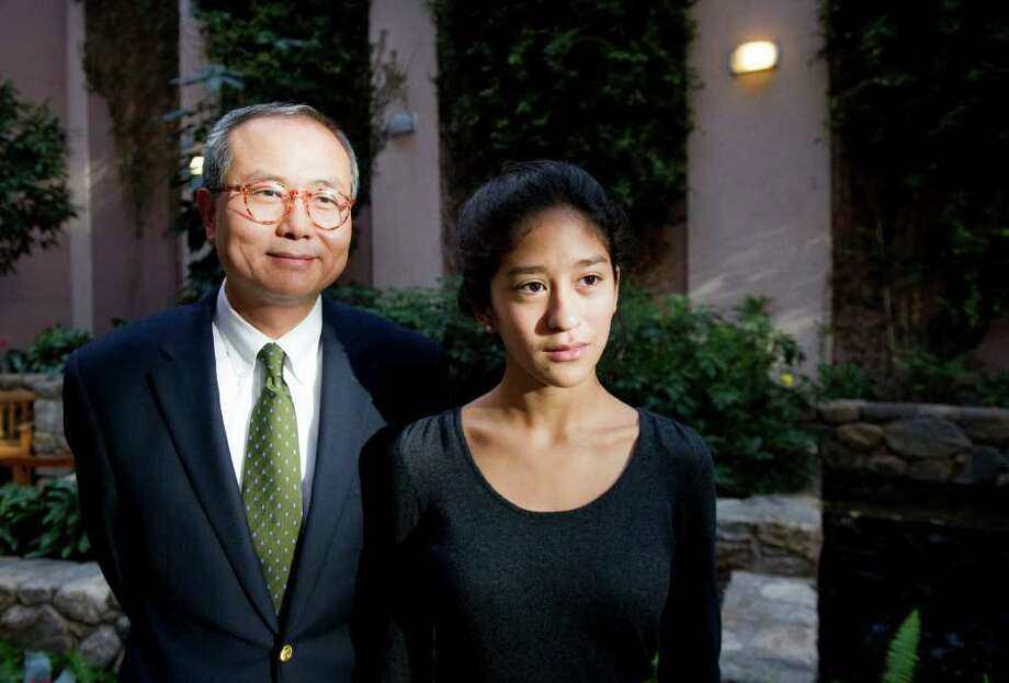 North Stamford resident and oncologist Dr. Steve Lo and his daughter Anna photographed in the Bennett Cancer Center in Stamford, Conn., Sept. 20, 2011.  Together they researched whether environmental contamination in North Stamford has caused cancer clusters in the area. Photo: Keelin Daly / Stamford Advocate