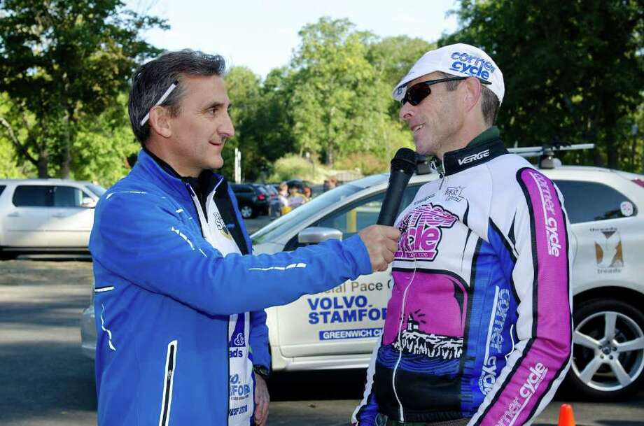 Race director Mickey Yardis, left, interviews overall winner Daniel Fox, 45, of Wilton after the conclusion of the Volvo of Stamford Tour de Greenwich XXVII, a 20-mile bicycle raceSunday morning at Greenwich High School. Photo: Contributed Photo