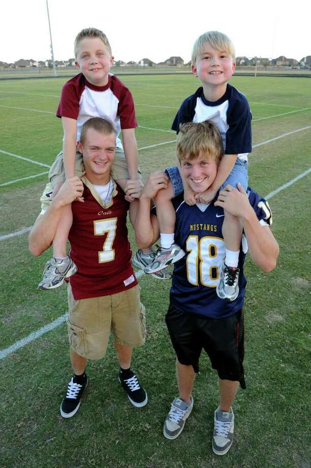 THOMAS NGUYEN: FOR THE CHRONICLE ON THE SAME TEAM: Wyatt Keenan, 8, left, pairs up with Cypress Woods' Gary Tesch, No. 7, and Nicholas Bullers, 8, teams up with Cypress Ranch's Ryne Ferguson, No. 18. Photo: Thomas Nguyen / Freelance