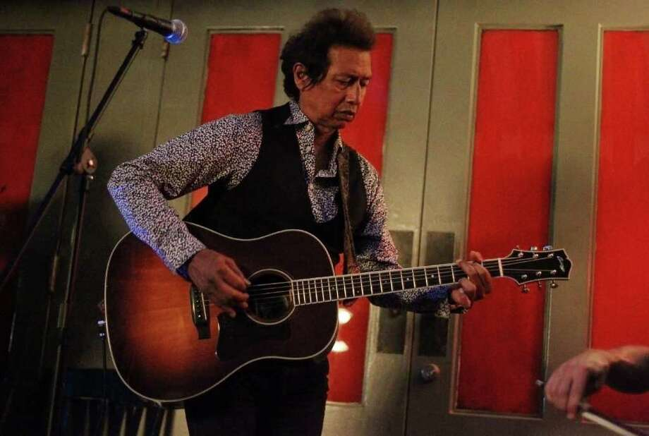 "Acclaimed singer-songwriter Alejandro Escovedo performs at the Havana Hotel's Ocho Lounge. His new ""Street Songs of Love"" is a rock 'n' roll album. KIN MAN HUI / EXPRESS-NEWS Photo: KIN MAN HUI, SAN ANTONIO EXPRESS-NEWS / SAN ANTONIO EXPRESS-NEWS"