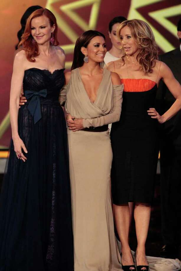 "Marcia Cross, (from left) Eva Longoria and Felicity Huffman get playful when ""Desperate Housewives"" wins the ALMA for Favorite TV Series. NBC Photo: NBC"