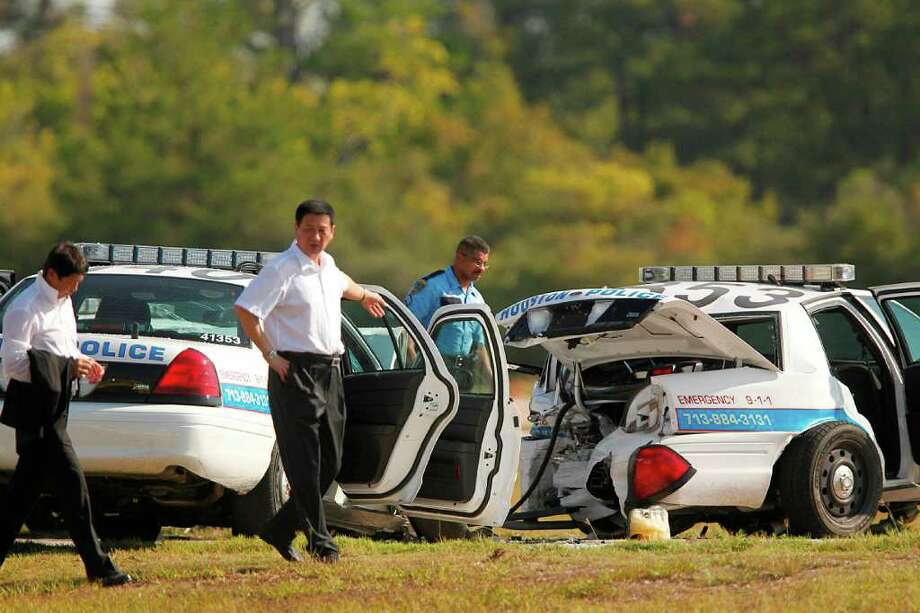 Mayra Beltrán : Chronicle 7 HURT: Five visiting Chinese officials from Houston's sister city of Shen Zhen were among the injured Tuesday when a driving maneuver at the Police Academy track went awry. Photo: Mayra Beltran / © 2011 Houston Chronicle