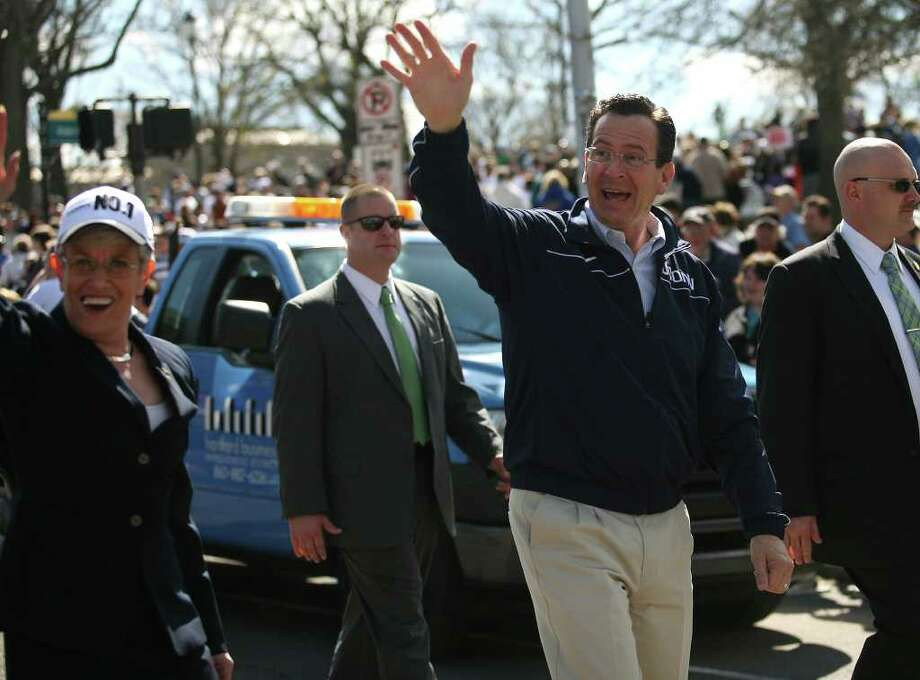 "Lt. Gov. Nancy Wyman and Gov. Dannel P. Malloy march in the UConn men's basketball NCAA Championship victory parade in Hartford on Sunday, April 17, 2011. Malloy told Hearst Connecticut Newspapers on Tuesday, Sept. 20, 2011 that he's ""available for consult"" to President Susan Herbst and others as UConn seeks a path to conference stability. Photo: Brian A. Pounds, ST / Connecticut Post"