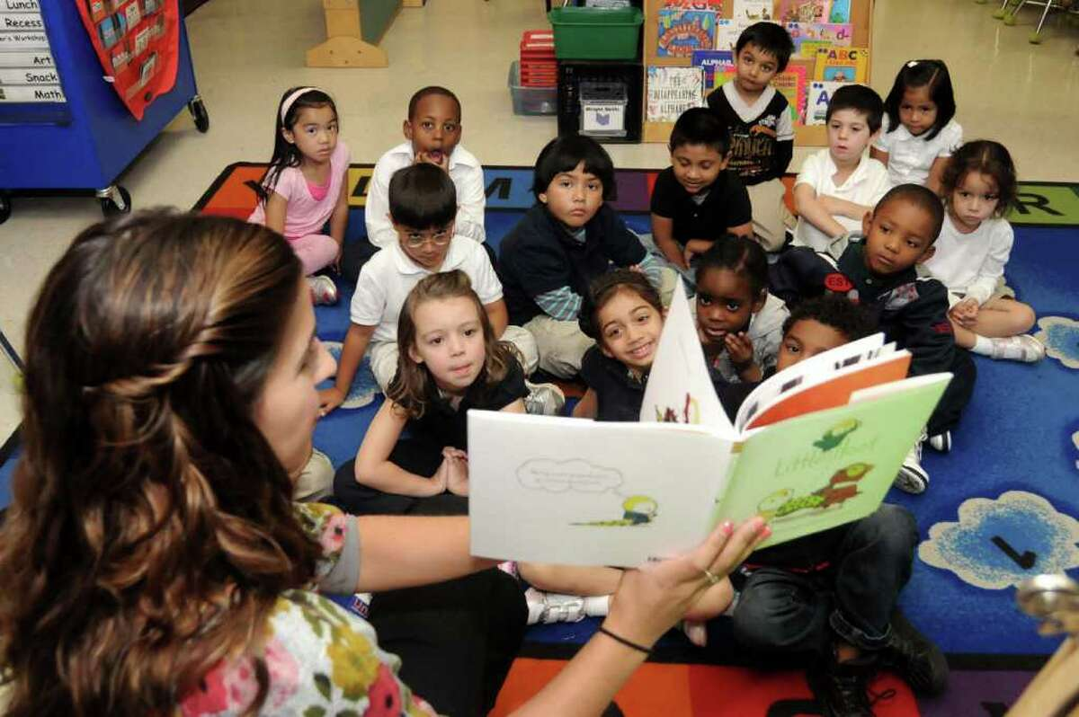 Danielle Madalon, a kindergarten teacher at K.T. Murphy Elementary school, reads the book, Little Hoot, to her class on Tuesday Sept. 20, 2011. Each student will get a copy of the book to take home courtesy of the Kiwanis Club of Stamford.