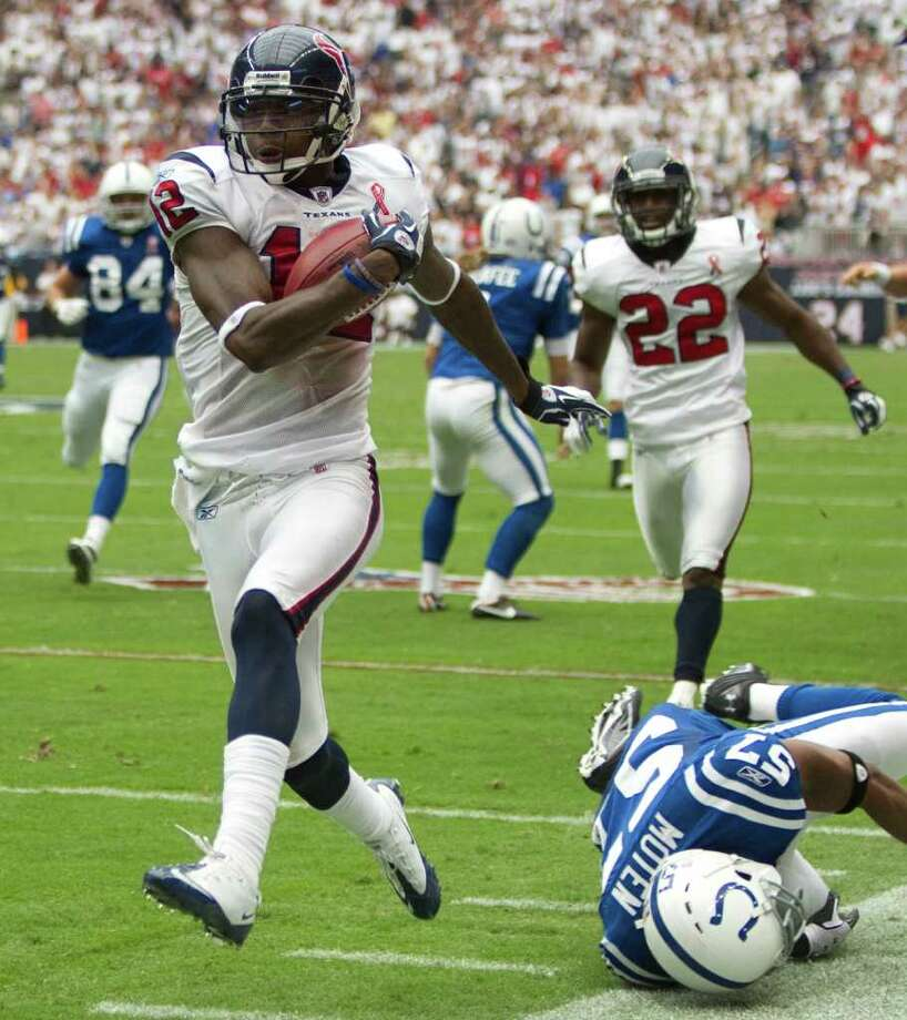 Jacoby Jones (12) gives the slip to the Colts' grounded Adrian Moten (57) as he returns a punt for a 79-yard touchdown in the Sept. 11 opener. Jones is one of many bright spots on the Texans' special-teams units. Photo: Brett Coomer / © 2011 Houston Chronicle