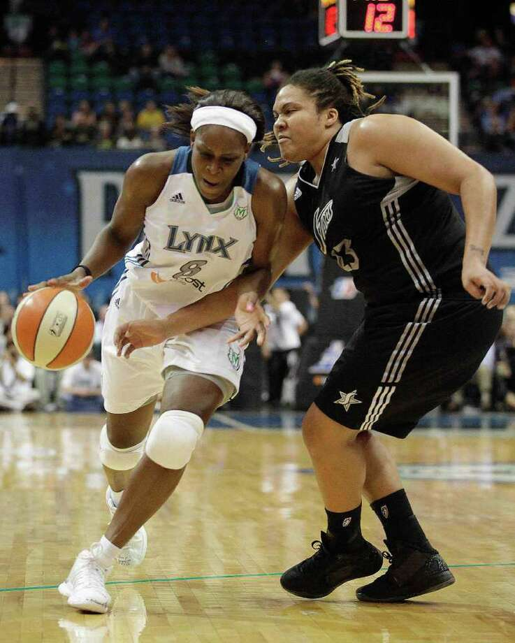 Minnesota Lynx forward Taj McWilliams-Franklin (8) drives the ball past San Antonio Silver Stars forward Danielle Adams (23) in the second half of Game 3 of a first-round WNBA playoff basketball series, Tuesday, Sept. 20, 2011, in Minneapolis. The Lynx won 85-67. Photo: Stacy Bengs/Associated Press