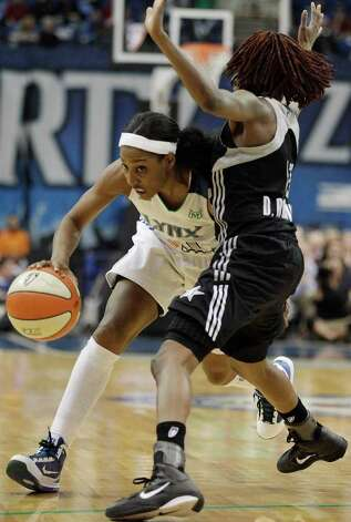 Minnesota Lynx's  Candice Wiggins (11) drives past San Antonio Silver Stars' Danielle Robinson in the second half of Game 3 of a first-round WNBA playoff basketball series, Tuesday, Sept. 20, 2011, in Minneapolis. The Lynx won 85-67. Photo: Stacy Bengs/Associated Press