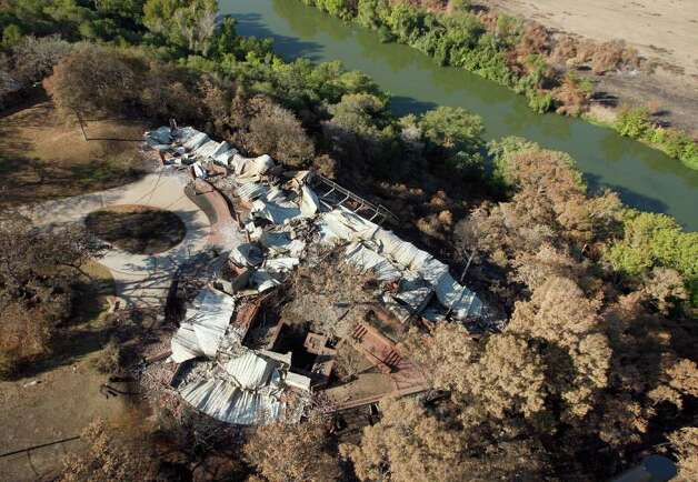 A destroyed home on the bank above the Colorado River in the Bastrop County Complex wildfire area is seen in this Tuesday Sept. 20, 2011 aerial photo. The wild fire, which has become the most destructive in Texas' history, started September 5 and burned more than 34,000 acres. Photo: WILLIAM LUTHER, William Luther/wluther@express-news.net / 2011 SAN ANTONIO EXPRESS-NEWS