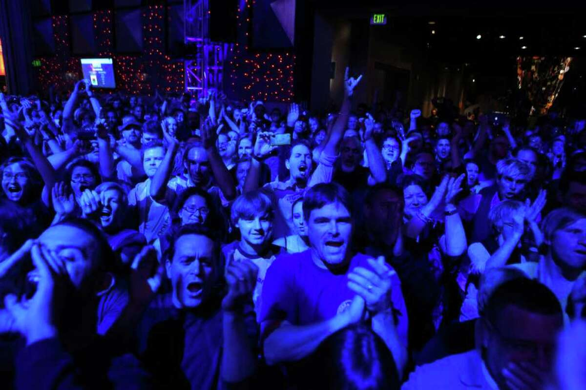 Fans cheer as Krist Novoselic asks them to remember Nirvana frontman Kurt Cobain during a Nirvana tribute show and fund-raiser at the Experience Music Project in Seattle.