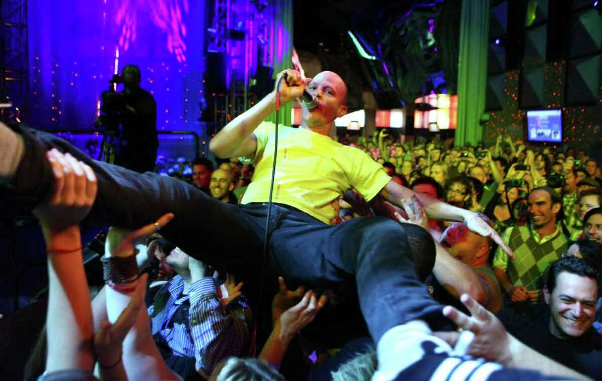Chris Ballew of The Presidents of the USA is carried by the crowd as he performs