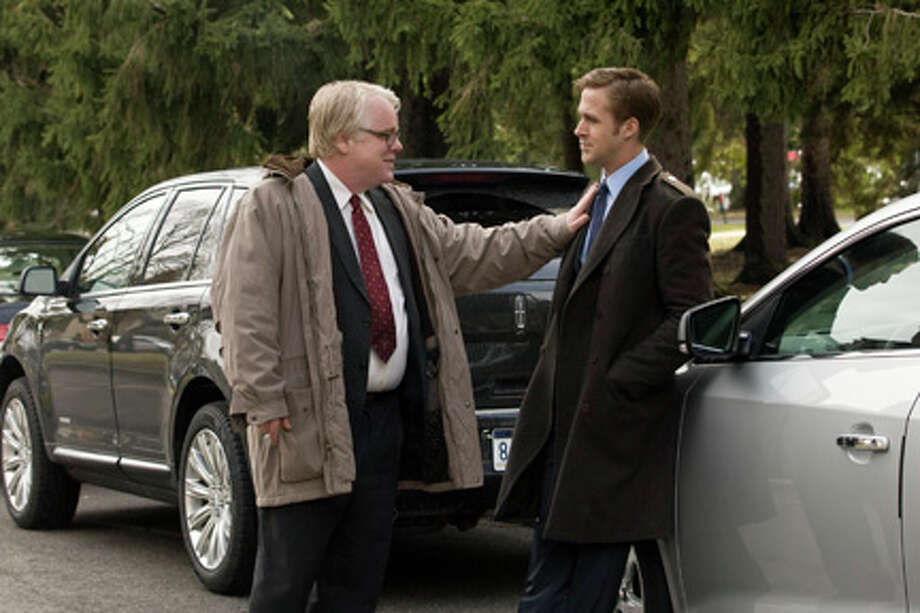 "Philip Seymour Hoffman as Paul Zara and Ryan Gosling as Stephen Myers in ""The Ides of March."""