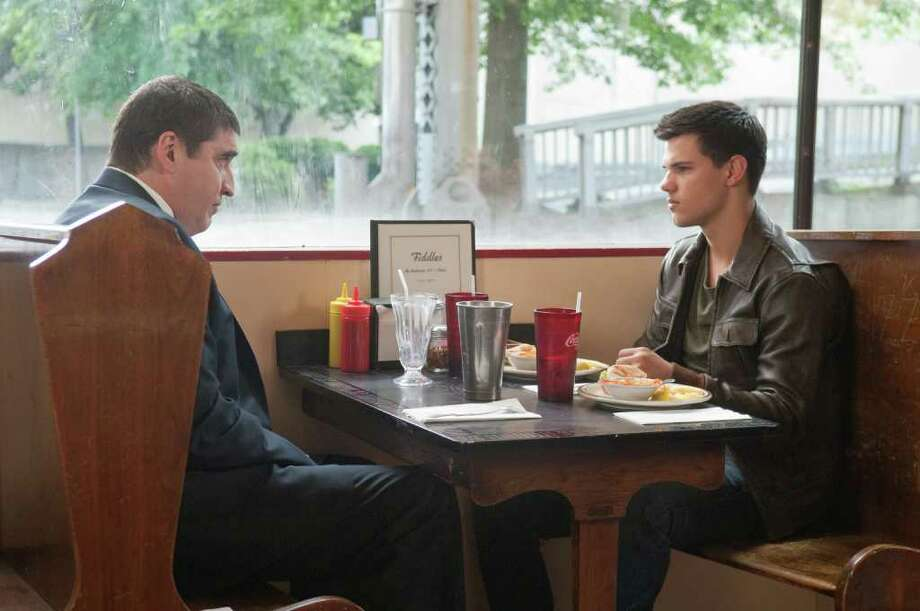 Burton (Alfred Molina, left) and Nathan (Taylor Lautner, right) in ABDUCTION. Photo: Photo Credit: Bruce Talamon, Courtesy Photo
