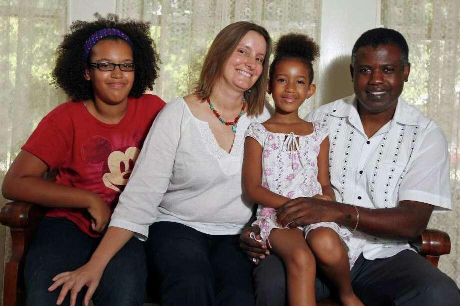 Portrait of the Cuero family Neenah, 11, (from left), Kimberley, Leelah, 6, and Ruben Sunday Sep. 18, 2011 at their home. Photo: EDWARD A. ORNELAS, EDWARD A. ORNELAS/eaornelas@express-news.net / © SAN ANTONIO EXPRESS-NEWS (NFS)