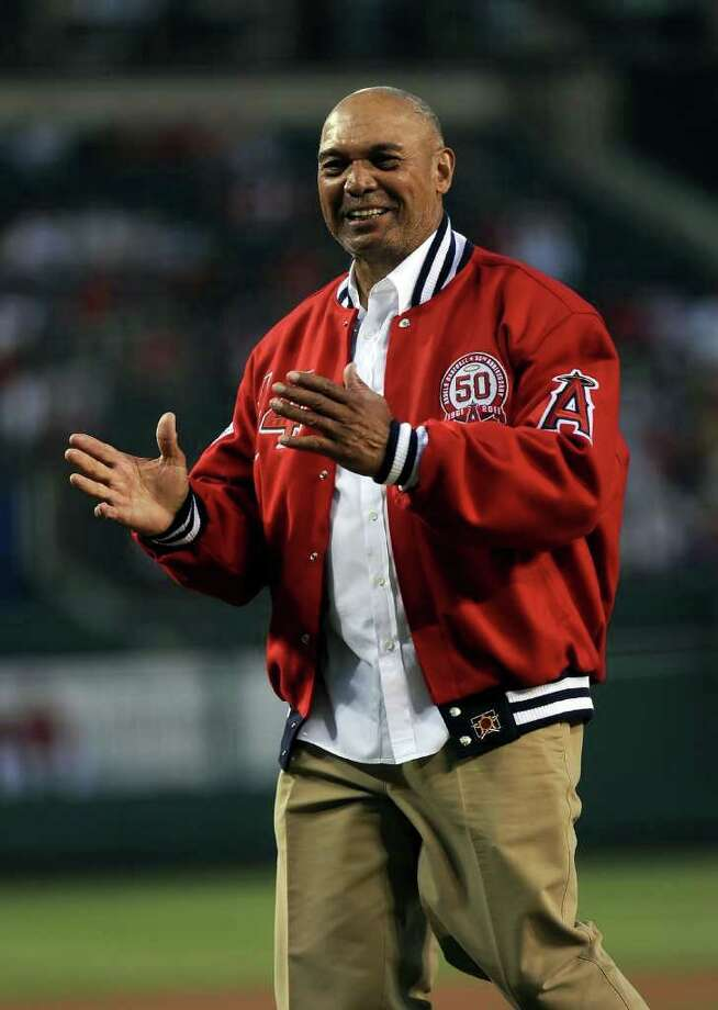 Former Player Reggie Jackson throws out the first pitch before the game between the New York Yankees and the Los Angeles Angels of Anaheim at Angel Stadium of Anaheim on September 9, 2011 in Anaheim, California. Photo: Lisa Blumenfeld, Getty Images / 2011 Getty Images