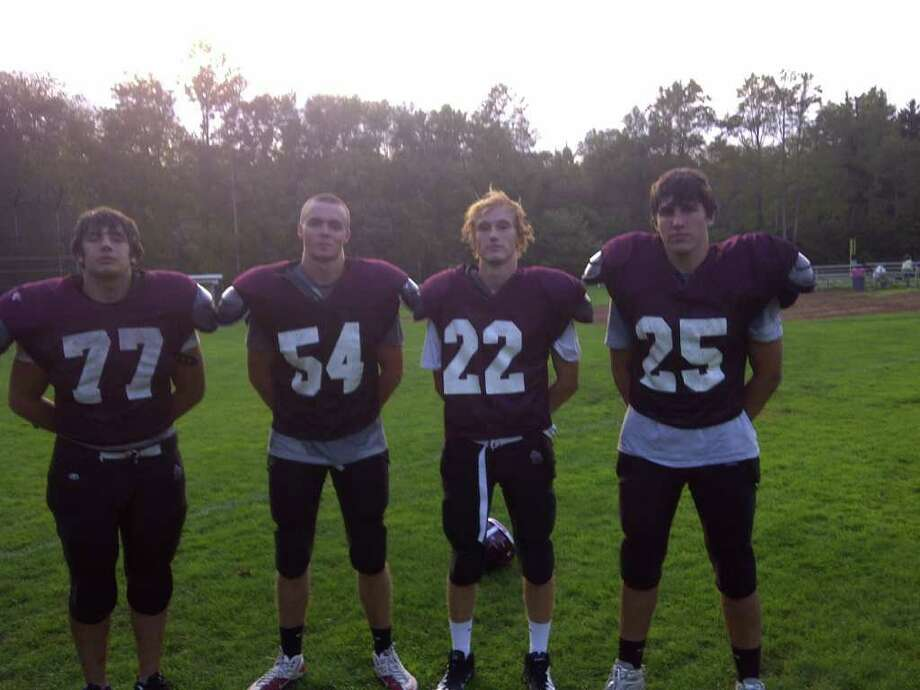 From left, St. Luke's football captains Joe Bonaddio, Sam Fuller, Greg Sellhausen and Adam Connolly pose for a picture after practice on Tuesday Sept. 20 at St. Luke's High School. St. Luke's opens its season with a home game against Hopkins at 1 p.m. Saturday. Photo: Jon Chik