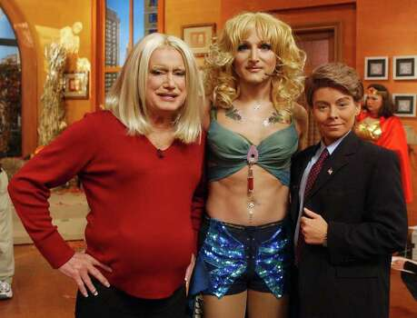 "Regis Philbin, left, and co-host Kelly Ripa, right, of ""Live With Regis and Kelly"" played role reversal dressing as each other for their Halloween program, in New York Thuersday Oct. 31, 2002. They flank the show's producer Michael Gelman dressed as Britney Spears. (AP Photo/Buena Vista Televison, HO)  HOUCHRON CAPTION (11/01/2002):  Regis Philbin, left, and co-host Kelly Ripa, right, of ""Live with Regis and Kelly"" play role reversal dressing as each other for their Halloween program in New York on Thursday. They flanked the show's producer, Michael Gelman, dressed as Britney Spears. Photo: AP / BUENA VISTA TELEVISION"