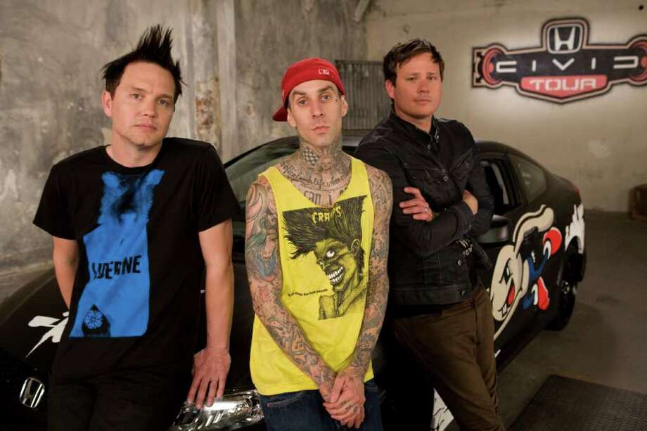 welcome to the neighborhood It's taken Mark Hoppus, from left, Travis Barker and Tom DeLonge two years to finish blink-182's latest album, Neighborhoods, but the members say their commitment to the band remains the top priority. Photo: Honda Civic Tour