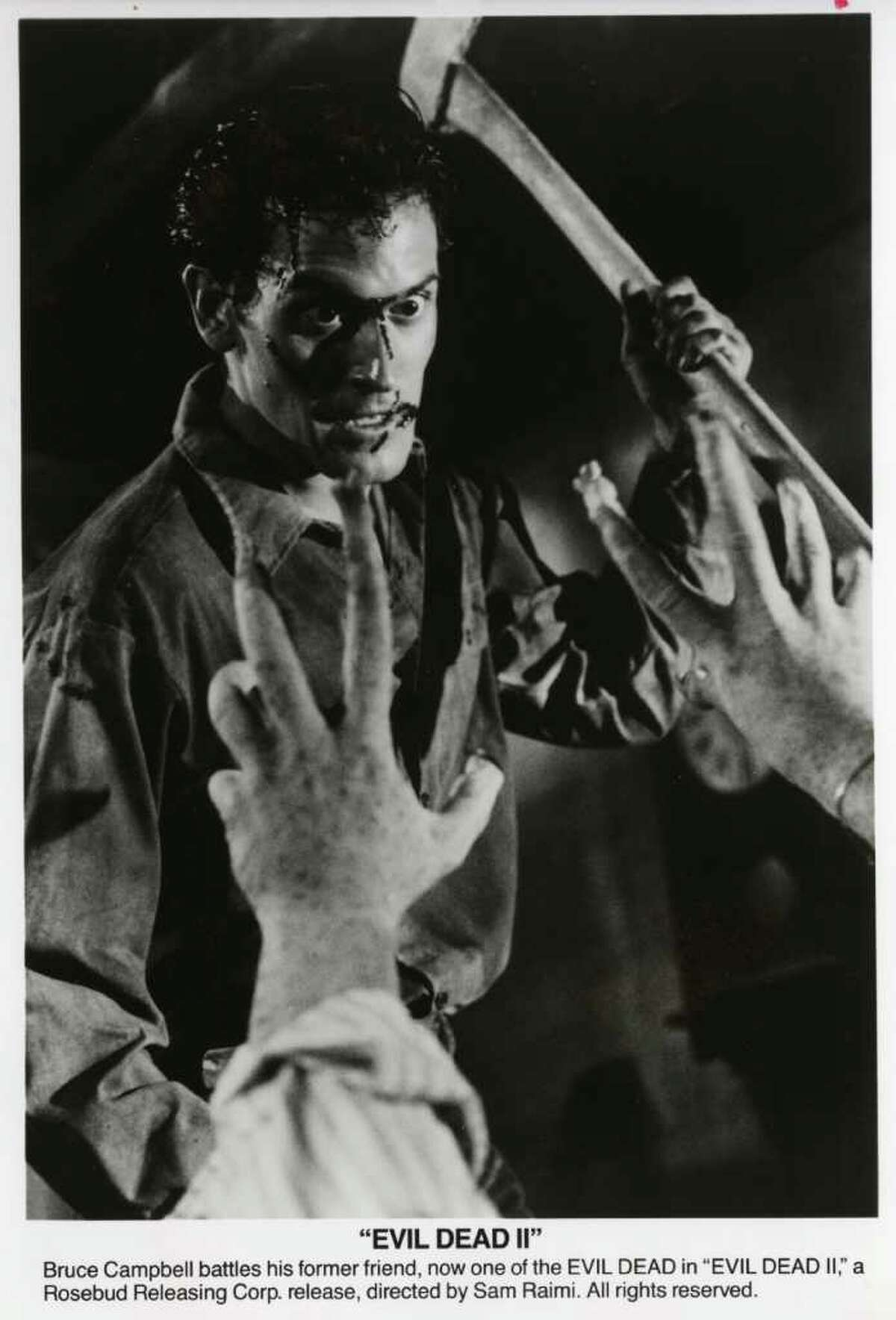 """EVIL DEAD 2 -- Bruce Campbell battles his former friend, now one of the EVIL DEAD in """"EVIL DEAD II,"""" a Rosebud Releasing Corp. release, directed by Sam Raimi. 1987 Rosebud Releasing Corp."""
