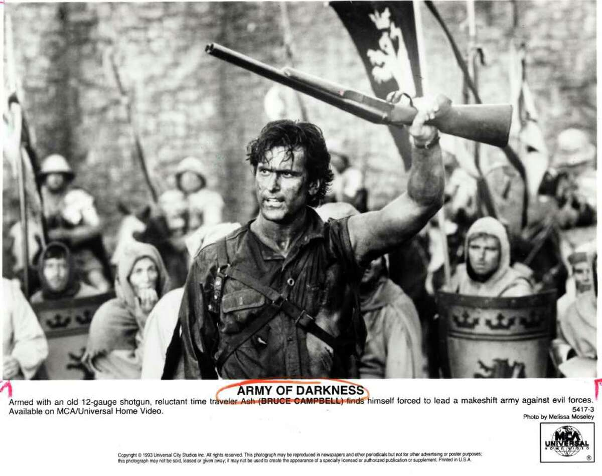 ARMY OF DARKNESS - Armed with an old 12-gauge shotgun, reluctant time traveler Ash (BRUCE CAMPBELL) finds himself forced to lead a makeshift army against evil forces. Available on MCA/Universal Home video. HOUCHRON CAPTION (08/06/1993): Bruce Campbell stars as Ash, a reluctant time traveler, in Army of Darkness.