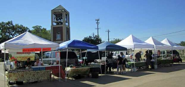 Vendors await customers at the Spring Branch Farmers Market. Photo: Syd Kearney