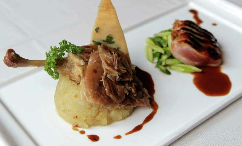 Duo of duck at Le Mistral.   Photo: Melissa Phillip / © 2011 Houston Chronicle