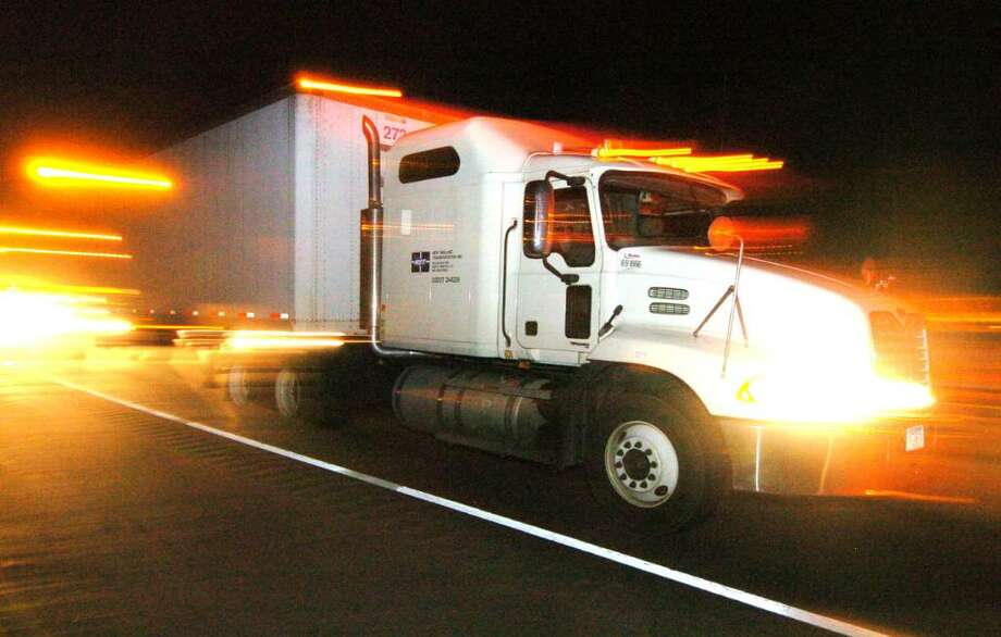 A semi-truck driving east bound on I-84 Friday, Oct. 16, 2009. Photo: Chris Ware / The News-Times