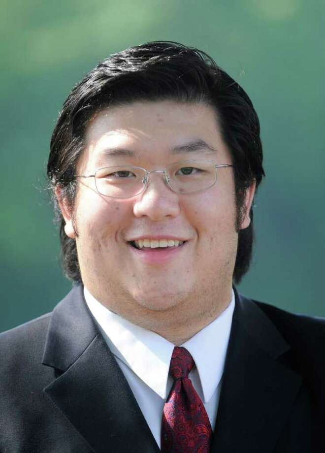 Stephen Ng, Democrat candidate for Greenwich town clerk, near his Cos Cob home, May 27, 2011. Photo: Bob Luckey, Greenwich Time / Greenwich Time