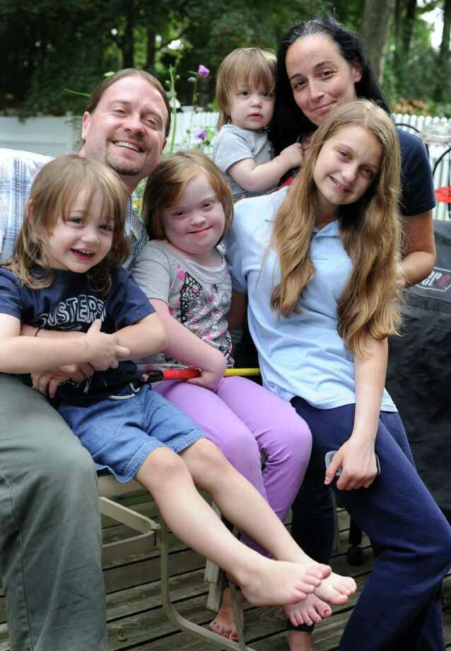 Charlie and Marianne Flanagan of Danbury sit with their children - from left, Charles Francis, 3; Katie Ann, 11; Hunter James, 18 months; and Victoria Rose,12.  Photo taken Wednesday, Sept. 21, 2011. Photo: Carol Kaliff / The News-Times