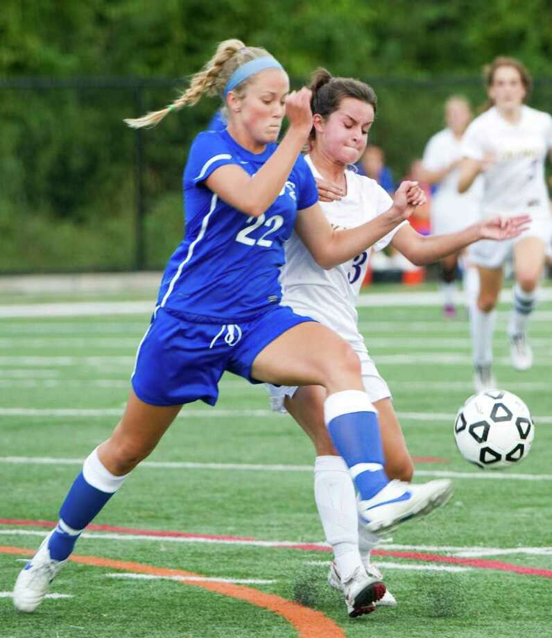 Darien's India Tibbets and Westhill's Alex Maciejewski in action as Westhill High School hosts Darien in a girls soccer game in Stamford, Conn., Sept. 21, 2011. Westhill won 2-0. Photo: Keelin Daly / Stamford Advocate