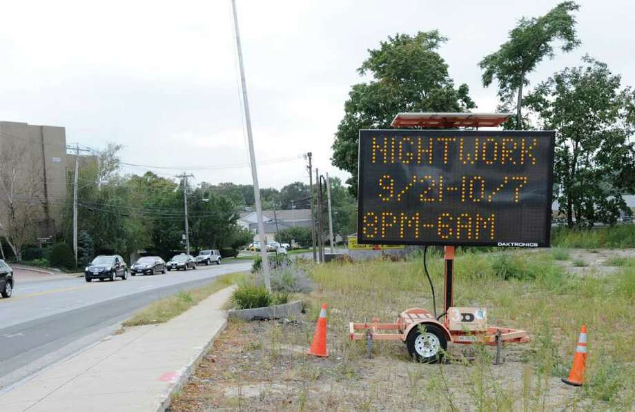 A sign in a vacant lot at the corner of Deerfield Drive and West Putnam Avenue (at left) Tuesday, Sept. 20, 2011, warns of nightwork Sept. 21 through Oct. 7, from 8 p.m. to 6 a.m.  Another sign, with a similar alert, is located at the beginning of West Putnam Avenue when entering Greenwich from New York State. Photo: Bob Luckey / Greenwich Time
