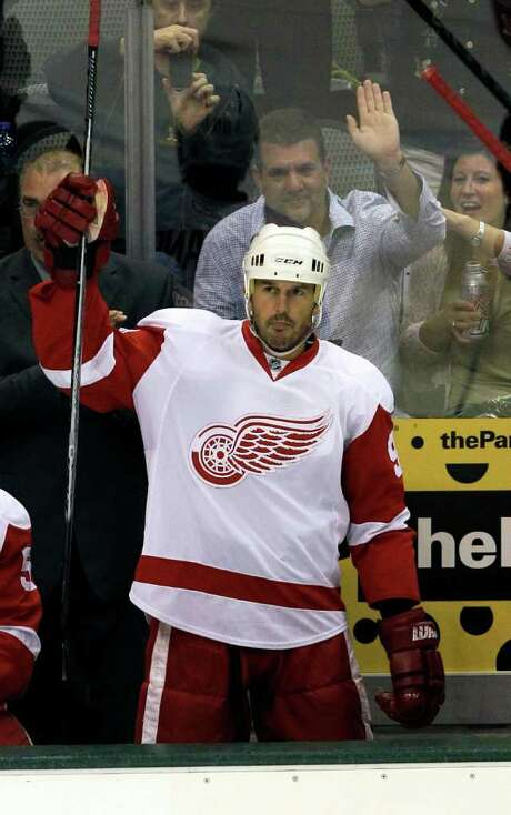 FILE - This Oct. 14, 2010, file photo shows Detroit Red Wings center Mike Modano lifting his stick to applause during the first period of a hockey game against his former team,  the Dallas Stars, in Dallas. Modano is retiring after 21 seasons in the NHL. Modano, in a phone interview Wednesday, Sept. 21, 2011, from Dallas, said he recently declined a chance to continue his career with the Vancouver Canucks. (AP Photo/LM Otero, FIle) Photo: LM Otero / AP2010