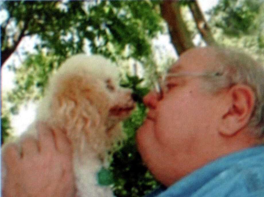Richard Stewart with one of his poodles when he was living in Brazos County. Enterprise file photo Photo: File
