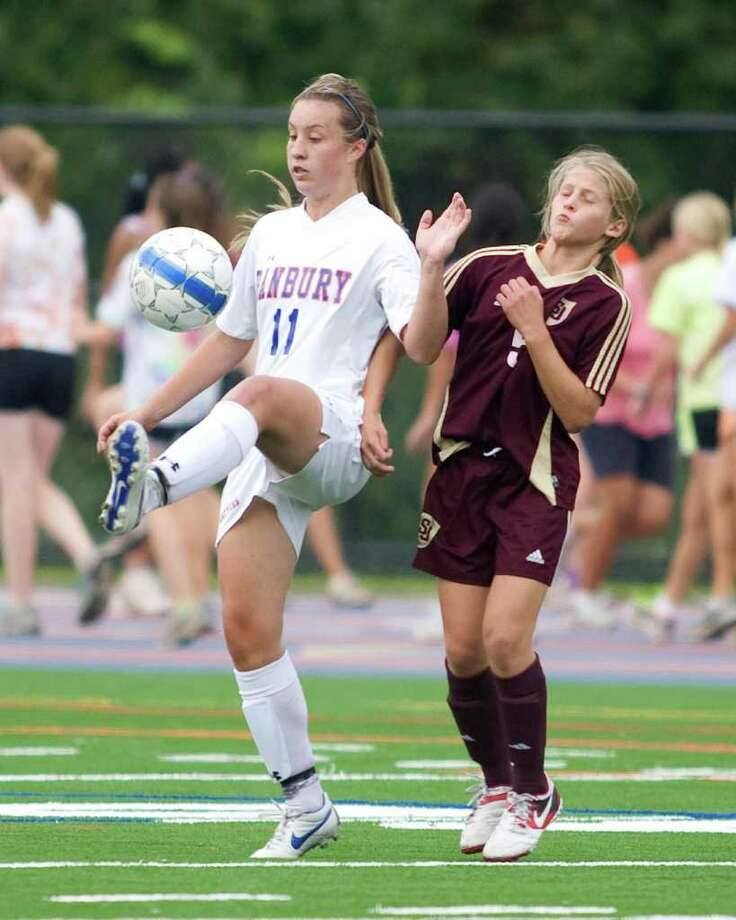 "Danbury's Rachel Gartner gets her foot on the ball in front of St. Joseph""s Julia Marino Wednesday at Danbury High School. Photo: Barry Horn / The News-Times Freelance"