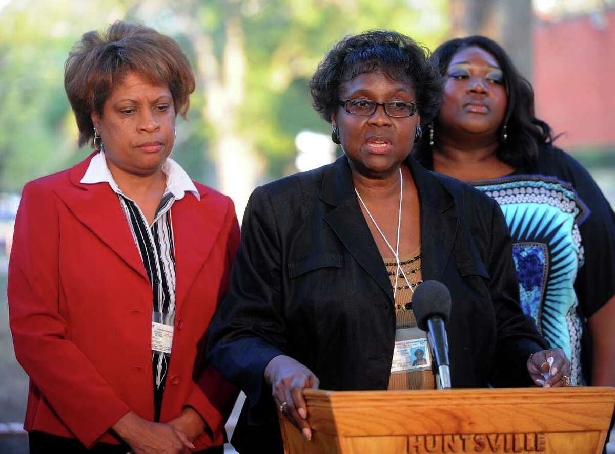 Clara Taylor, sister of the late James Byrd Jr., said she promised her mother, Stella, who passed away last year, that she would attend the execution of the men who Byrd. Louvon Harris, left, and Tiffany Taylor, Byrd's sister and niece, stood with her for support. Guiseppe Barranco/The Enterprise