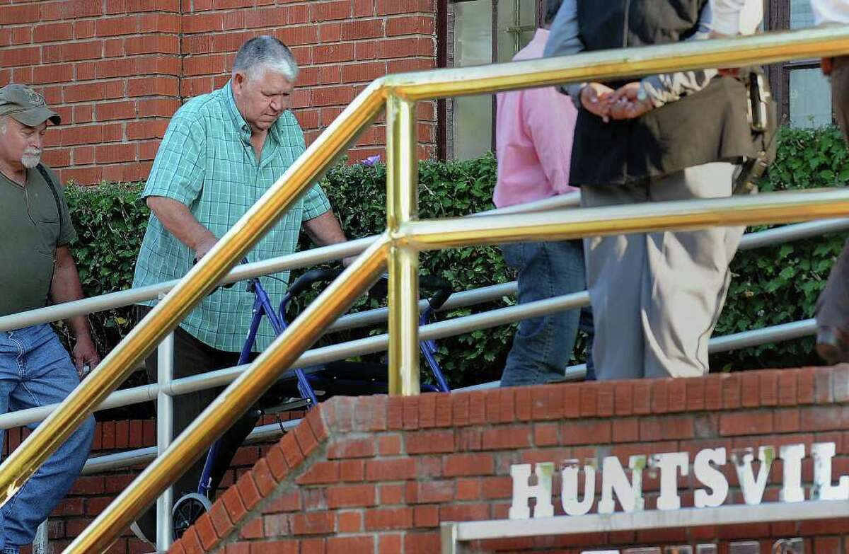 Lawrence Brewer Sr., father of Lawrence Russell Brewer,. walks into the Huntsville prison's Walls Unit Wednesday before his son's execution for the 1998 dragging death of James Byrd Jr. Guiseppe Barranco/The Enterprise