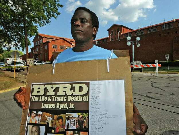 Ricky Jason, a documentary film maker who covered the death of James Byrd Jr., said he opposes the death penalty. He protested Lawrence Rusell Brewer's execution outside the Huntsville prison Wednesday. Guiseppe Barranco/The Enterprise