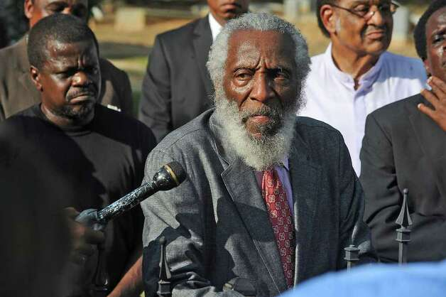 Dick Gregory address a small gathering at James Byrd's grave during a memorial in Jasper Tuesday night.  Guiseppe Barranco/The Enterprise Photo: Guiseppe Barranco