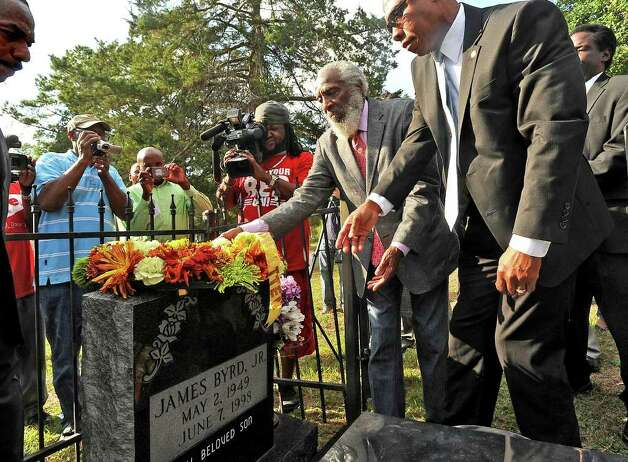 Dick Gregory and Jasper Police Chief Rodney Pearson laid a wreath on James Byrd Jr.'s grave Tuesday night. The wreath bore a ribbon that said: Never Forgotten. Guiseppe Barranco/The Enterprise Photo: Guiseppe Barranco