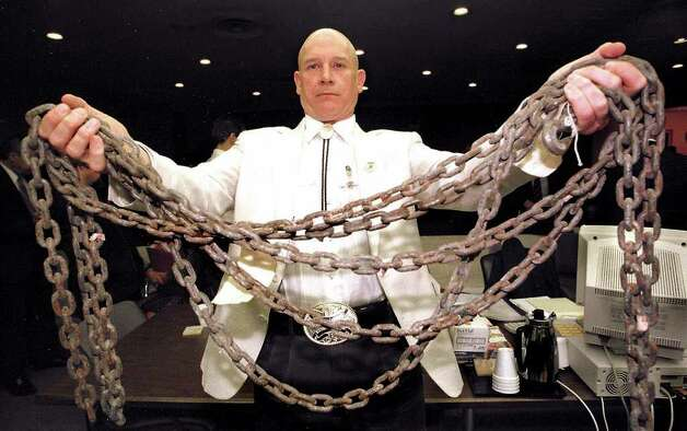 Jasper County Assistant District Attorney Pat Hardy displays the chain allegedly used to drag James Byrd Jr. to his death during a break in the trial of Lawrence Russell Brewer Thursday, Sept. 16, 1999, at the Brazos County Courthouse in Bryan, Texas.  The chain was introduced into evidence Thursday. Brewer is the second of three white men charged with capital murder in the dragging death of James Byrd Jr. near Jasper, Texas. (AP Photo/Pool, Butch Ireland) Photo: BUTCH IRELAND, POOL / POOL COLLEGE STATION EAGLE