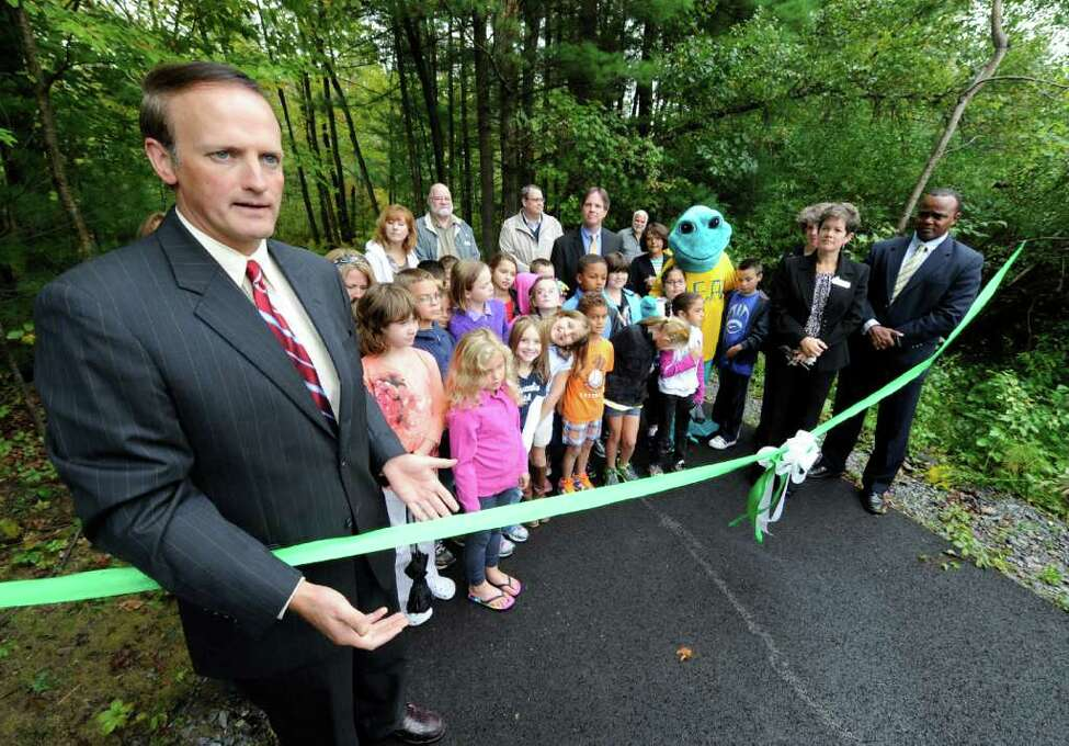 Clifton Park Supervisor Philip Barrett, left announces the opening of the new Liberty Trail linking the Moe Road trail system with Clifton Park, N.Y. town center during a ceremony at the trail head near the Clifton Park Town Library September 21, 2011. (Skip Dickstein / Times Union)