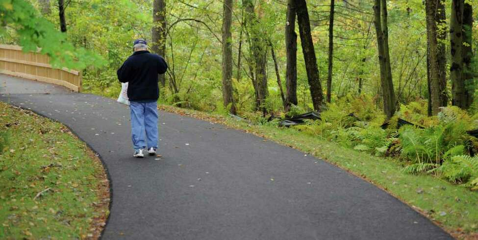 A person enjoys the new Liberty Trail linking the Moe Road trail system with Clifton Park, N.Y. town center September 21, 2011. (Skip Dickstein / Times Union)
