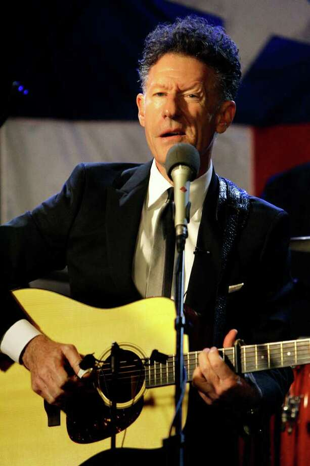 Lyle Lovett performs during a live broadcast at the HoustonPBS LeRoy and Lucile Melcher Center for Public Broadcasting Wednesday, Sept. 21, 2011, in Houston. Photo: Cody Duty, Houston Chronicle / © 2011 Houston Chronicle