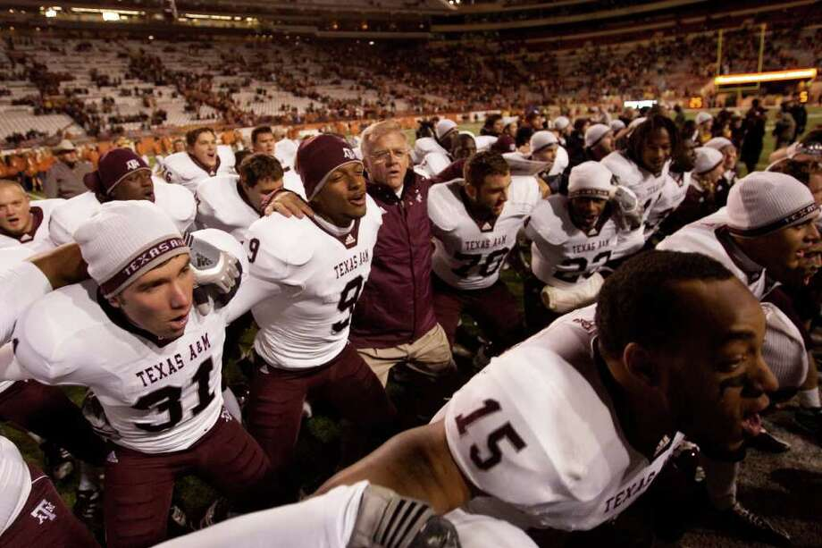 Mike Sherman, head coach of Texas A&M, joins players in a post-game singing of the Aggie War Hymn following Texas A&M's 24-17 win over the University of Texas at Darrell K. Royal-Texas Memorial Stadium on November 25, 2010 in Austin, Texas. (Darren Carroll/Getty Images) Photo: Darren Carroll, Associated Press / 2010 Getty Images