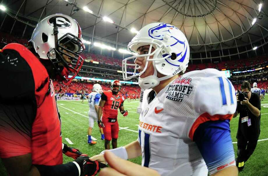 When quarterback Kellen Moore (right) and Boise State took on Georgia at the beginning of the season on Sept. 3, both teams made a splash with their eye-catching uniforms and apparel. SCOTT CUNNINGHAM/GETTY IMAGES Photo: Scott Cunningham, Associated Press / 2011 Getty Images