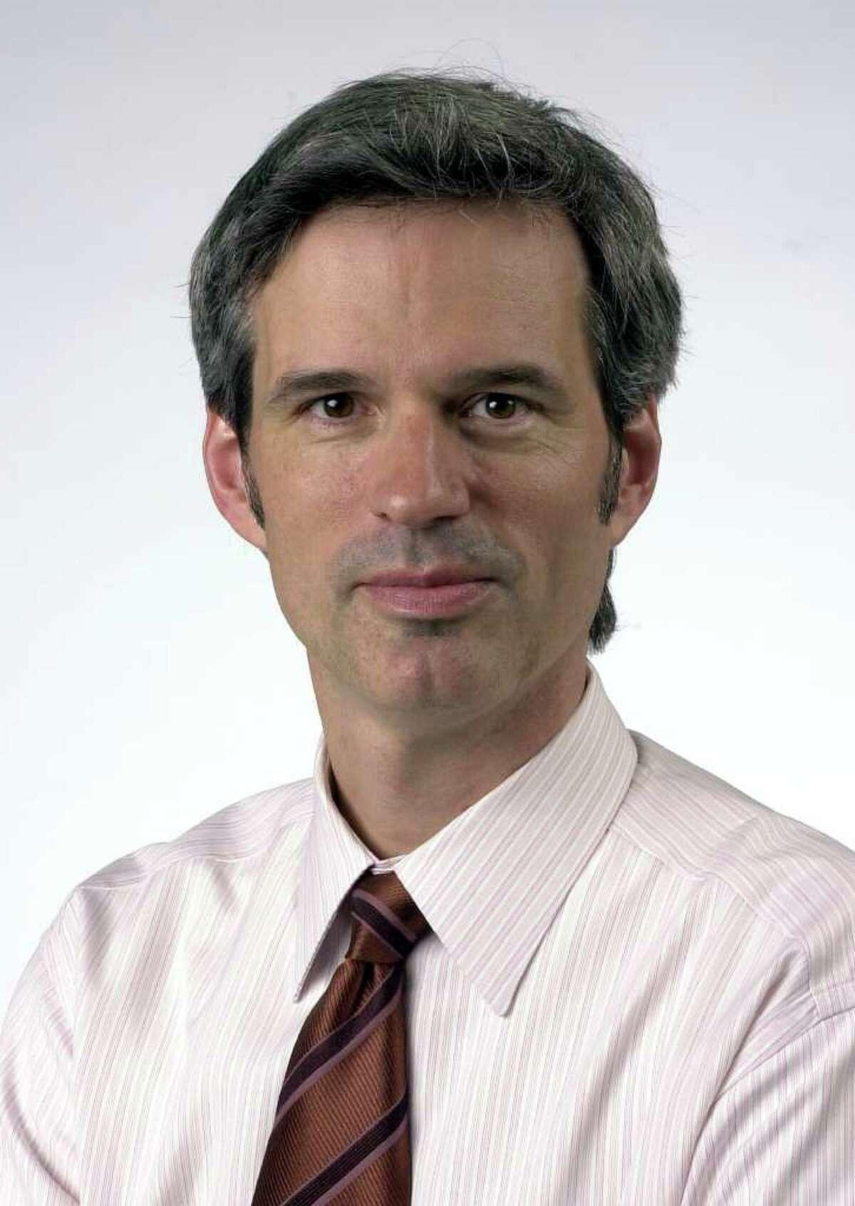Brett Thacker: He was named E-N's managing editor in August 2003.